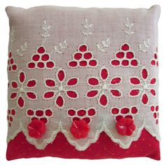 Lavender-filled sachet crafted from vintage white eyelet overlaid on solid red fabric and accented with three red flower-shaped buttons.