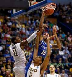 03-23-2014  Kentucky forward Willie Cauley-Stein dunked over Wichita State forward Cleanthony Early and forward Darius Carter photo by Charles Bertram, Herald-Leader