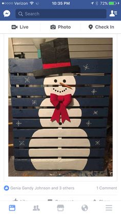 Pallet snow man  with blue back ground and icicles