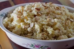 Rice pilafdressed up with sliced almonds and a pinch of saffron. This pressure cooker version cooks in the pressure cooker in only 3 minutes.
