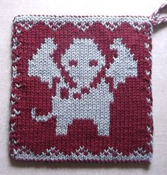 Free Knitting Pattern for Elephant Pot Holder - Double knit reversible design with elephant motif that can be adapted for use with different techniquesintarsia, knit-purl relief, duplicate stitch, etc. You can also use it for afghan blocks, baby clothes, wash cloths, and more. Designed by Susi Sunshine. Pictured project by tanja39