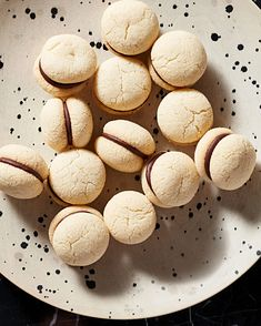 "Mini Chocolate-Filled Cookies Recipe | Martha Stewart Living — Italian for ""lady's kisses,"" these little sandwich cookies layered with dark chocolate are a perfect accompaniment to an after-dinner espresso."