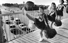 Pompom squad members from Bryan High School drum up some homecoming spirit on the pedestrian overpass on Dodge Street at Memorial Park. The high-kickers are, from left, Pa Vang, 16, Michelle Walters, 18 and Kati Fanslau, 16. This photo ran on Sept. 29, 1987. THE WORLD-HERALD