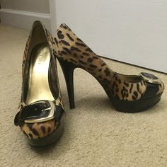 Nine West Platform Heels Leopard print platform heels from Nine West. Gold and black patent leather buckle on toe. Excellent condition. Worn for 2 hours in Las Vegas. Size 7. NO TRADES! Nine West Shoes Heels
