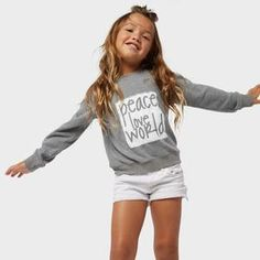 """A kids pullover comfy top featuring a wide boat-neck, natural-fit body that ends with a bound lower hem, long sleeves, and a """"peace love world"""" graphic motif. Peace Love World, Peace And Love, Stitch Fix Fall, Make Her Smile, Love Words, Kids Outfits, Graphic Sweatshirt, Comfy, Sweatshirts"""