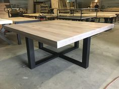 i want a dining table and sofa table stained gray with stainless steel legs like this with maybe a SS design on top that looks like a large droplet of paint Large Square Dining Table, Glass Dining Room Table, Slab Table, Metal Dining Table, Dining Room Sets, Metal Furniture, Home Decor Furniture, Stained Table, Home Room Design