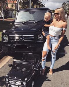 mama and baby black mercedes jeep