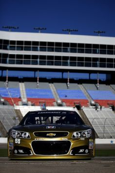 Dale Earnhardt Jr., driver of the #88 AMP Energy Gold / 7-Eleven Chevrolet, drives through the garage area during practice for the NASCAR Sprint Cup Series AAA Texas 500 at Texas Motor Speedway on November 2, 2013 in Fort Worth, Texas.