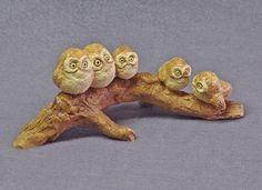 Handmade Ceramic Owl Family on a Log Ceramic by TCChiuSculpture