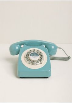 Inspired by a classic 1960's design, this adorable phone is crafted in a retro light blue hue!