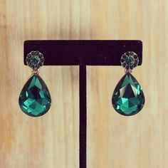 These emerald dangle earrings were made with crystal jewels. - Closure: Post Back - Plated Base Metal, crystal.  - Height: 2''- Lead
