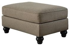 A soft yet supportive box cushion makes the Hariston ottoman as comfortable as it is stylish. Neutral upholstery goes with anything, while clean lines and curved feet add flair. Sectional Ottoman, Chair And Ottoman, Living Room Plan, Home And Living, Curved Wood, Mahogany Brown, Papasan Chair, Nebraska Furniture Mart, Furniture Collection