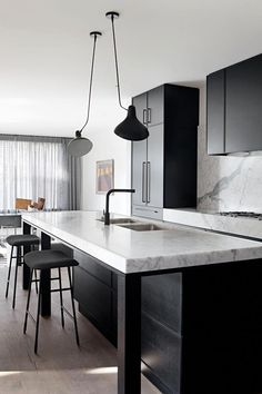 Family home reinvented with classic contemporary style Sleek black kitchen cabinetry is paired with marble benchtops and splashbacks in this classic contemporary home. Photography: Shannon McGrath - Add Modern To Your Life Modern Kitchen Interiors, Modern Kitchen Design, Interior Design Kitchen, Kitchen Decor, Black Interiors, Kitchen Ideas, Inspiration Design, Decoration Inspiration, Decor Ideas