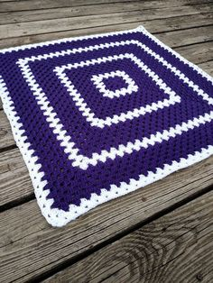 Purple crochet baby blanket! Want another size or color? Please contact me! I love special orders! Turnaround times as short as one week! Makes a great baby shower gift! Hand-made crochet baby blanket in a large purple and white granny square. Blanket measures 36 inches by 36 inches and is the perfect size for car seats, tummy time on the floor, strollers, photo props, and bassinets. Blanket is made from a soft acrylic yarn that is easy to care for. Blanket is machine washable, tumble dry…