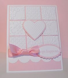 """""""I used several embossing folders and punched out 1 1/4 inch squares to form the grid and the used the Heart of Hearts embosslit for the heart. The white trim at the bottom was made using the Tasteful Trim die. The sentiment is from the stamp set Hope Happens"""""""