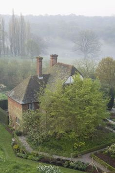 View over the South Cottage, at dawn, from the Tower at Sissinghurst Castle Garden, near Cranbrook, Kent
