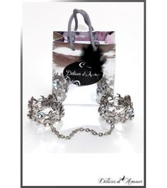 A mysterious feminine design!Handcuffs mounted on elastic, easy to put on,they will look great also as bracelets.Chainette 20cm detachable.These handcuffs comprise of large silver metal and are rhinestone encrusted.- Hypoallergenic - nickel free