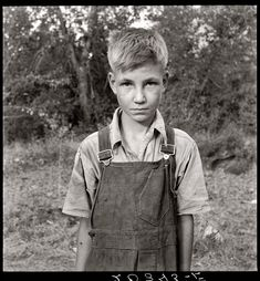 "August 1939. Migratory boy in squatter camp. Has come to Yakima Valley, Washington, for the third year to pick hops. Mother: ""You'd be surprised what that boy can pick."" ""Dorthea Lange captured the despair and grinding hopelessness found among many who endured the Depression. But at the same time, amazingly, she also manages to capture the set of the subject's jaw or the look in their eye that says ""just you wait, we're a great nation, we'll be back"" attitude they seemed to possess."""