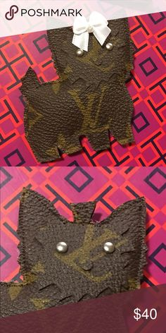 "Yorkie face, eyes, bead collar charm Handmade from authentic Louis Vuitton canvas! All items are made from authentic purses re-purposed.   One single tassel is included with your purchase. If not picked I will pick one for you when shipped. The extra long tassels are a $4 up charge. If it's in the listing the price is already added.   Comes with a bow, eyes and bead collar   Thanks for shopping ""Louie ReLoVed"" Louis Vuitton Accessories"