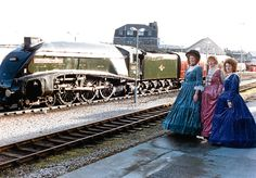 Joan Sinclair, Susan Thomson and Lorraine Ogg were suitably attired for the 125th birthday celebrations of Aberdeen railway station are. The A4 Pacific steam engine Union of South Africa is behind.