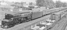 Pennsylvania Railroad T1 Duplex steam locomotive on a passenger train. Homewood Illinois circa 1940's.
