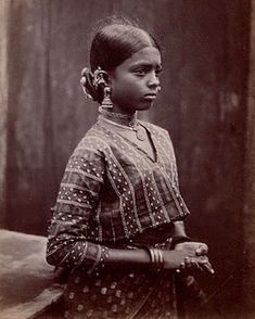 Tamil girl wearing a upper body tunic over a sari, 1912.  Source: Archaeological Survey of India Collections