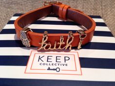 """Show your Faith with Keep Collective jewelry & bracelets. Shown here are the pave Hamsa, scrip Faith, & a Key charm. All in gold, on a orange/saddle reversible leather """"keeper"""". #ikeepfaith #keepstyle #charmsbyjill"""