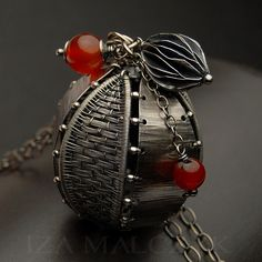 Pendant | Iza Malczyk.  Oxidized silver and carnelians