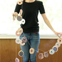 Create a doughnut garland with your children… | 19 DIY Doughnut Projects That Are Cute Enough To Eat