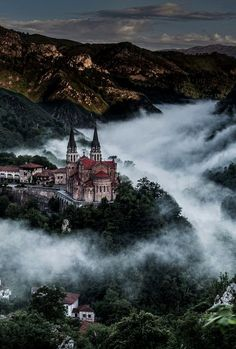 The Basilica of Santa María la Real of Covadonga, Spain sits above the early morning fog in the Picos de Europa mountains. Photo by Wilsonaxpe.