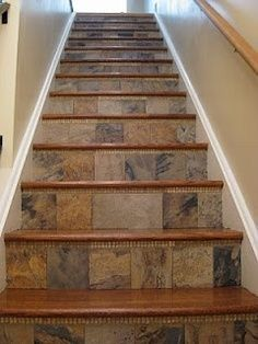 using slate tile for interior stair risers  -- this would be good on the front entry