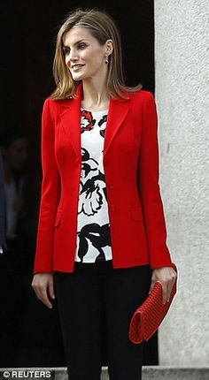 Spain's Queen Letizia leaves after attending the 75th anniversary of the Spanish National Research Council (CSIC) in Madrid