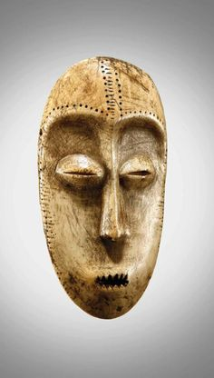 Africa | 'Idumu' mask from the Lega people of the DR Congo | Ivory. H: 18cms | ca. late 19th century