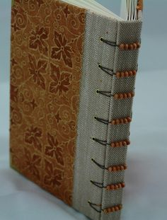 Love the bead detail & the combo of materials, in this one. Belgian binding from Lauren Ferguson