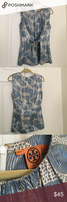 Tory Burch Top Silk Tory Burch top with metallic woven detail. Great w/ white skinnies for a summer party! Sz 12 pretty true to sz just a tad tight on a larger bust. Zipper back and fun adjustable cinched bow in front. Tory Burch Tops Blouses