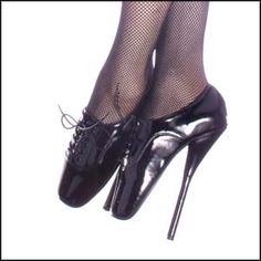 These extreme fetish shoes are sire to punish your submissive. Train her to walk in the extreme shoes with a 7 inch heel. Come in either black leather or black, red or white patent leather.