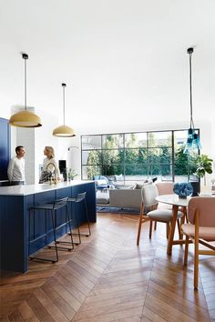 This renovated Edwardian home features parquetry flooring in the open plan kitchen, living and dining area. Gold pendant lights hang above the white kitchen benchtop. The kitchen cabinetry is painted a vivid navy, adding depth to the space. Home Decor Kitchen, Kitchen Cabinetry, Dining Room Design, Open Plan Kitchen Dining, Kitchen Decor, Open Plan Kitchen Living Room, Open Plan Living Room, Home Decor, Open Plan Kitchen Diner