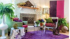 A white brick fireplace serves as a visual anchor for this eclectic living room, that mixes bright colors and metallics for a bohemian chic look. The purple rug helps unify the furniture to create a conversational grouping.