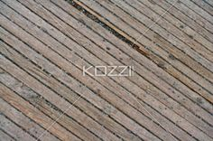 wooden boardwalk slats - Wooden Slats of a Boardwalk on an angle seen from above.