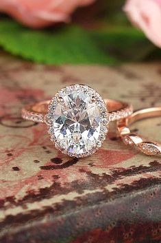 Diamond Engagement Ring - Center diamond oval halo rose gold diamond engagement rings - Tiger Gemstones #weddings #rings #weddingrings #engagementrings