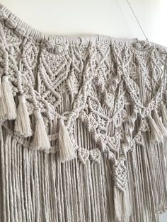This macrame wall hanging is hand-made by Hanifah Tohir in Sydney, Australia. The fibre art piece features a driftwood that is one of a kind and is made with 100% cotton in a neutral colour. It is perfect to hang in a living room or bedroom.   Measurements Length: 1.2m (stick end-to-end) Height: 1m