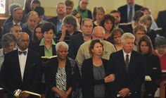 (From left) Story County Supervisor Wayne Clinton, Edna Clinton, wife of Wayne Clinton, Calli Sanders, wife of Rick Sanders and county supervisor Rick Sanders pray with other mourners during Story County Supervisor Paul Toot's funeral service at St. Patrick's Catholic Church Thursday. Photo by Nirmalendu Majumdar/Ames Tribune  http://amestrib.com/news/toot-remembered-servant-county