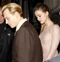 Newly blonde actor Johnny Depp and Amber Heard were photographed together for the first time since July going on a dinner date in London.