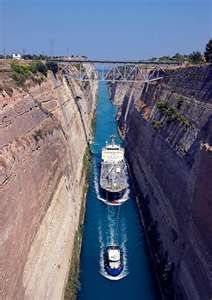 The canal of Corinth, Greece through the Isthmus of Corinth. The Canal is the most favourite itinerary for cargoes and transports among Mediterranean and Black Sea ports because it is the safest and cheapest access route to and from all destinations. Oh The Places You'll Go, Great Places, Places To Travel, Travel Destinations, Beautiful Places, Places To Visit, Corinth Canal, Corinth Greece, Crete Greece