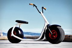 Scrooser 1 The Scrooser is the Harley Davidson of the sidewalk. This fantastic looking machine is a scooter which has a super silent battery powered engine inside the rear wheel. The makers claim that it'll last around 25 days in an urban environment. It does not require a license or helmet to use