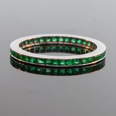 I love rings like this, and wish I could add this to my collection. Antique 1930's 18k White Gold Emerald Eternity Band