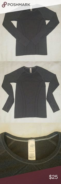 Ivivva by LULULEMON Athletica Grey Shirt (girls) This Ivivva long sleeve grey athletic shirt is by Lululemon.  It has thumb holes and is a size large (girls). Ivivva Shirts & Tops Tees - Long Sleeve