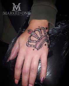 Girly hand tattoo. Pink crown on hand.