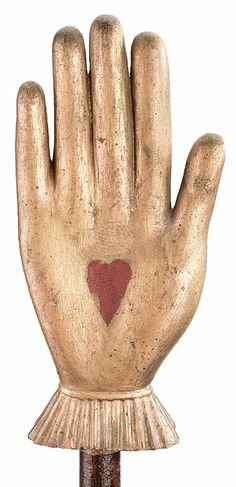 Odd Fellows staff symbolizing;  What ever the hand goes forth to do  the heart should go forth in unison.