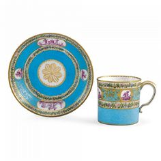 A SÈVRES CUP AND SAUCER 1780 gobelet litron et soucoupe  of the second size, the turquoise ground reserved with miniature classical scenes of putti  en camaïeu rose , the rims with wreaths,  wear to gilding   Quantity: 2 interlaced Ls mark enclosing dateletters cc for 1780, mark of a scrolling F, possibly for the painter and gilder Jean-Armand Fallot, cup with incised 45, saucer with C, Wilfrid Evill Collection Label